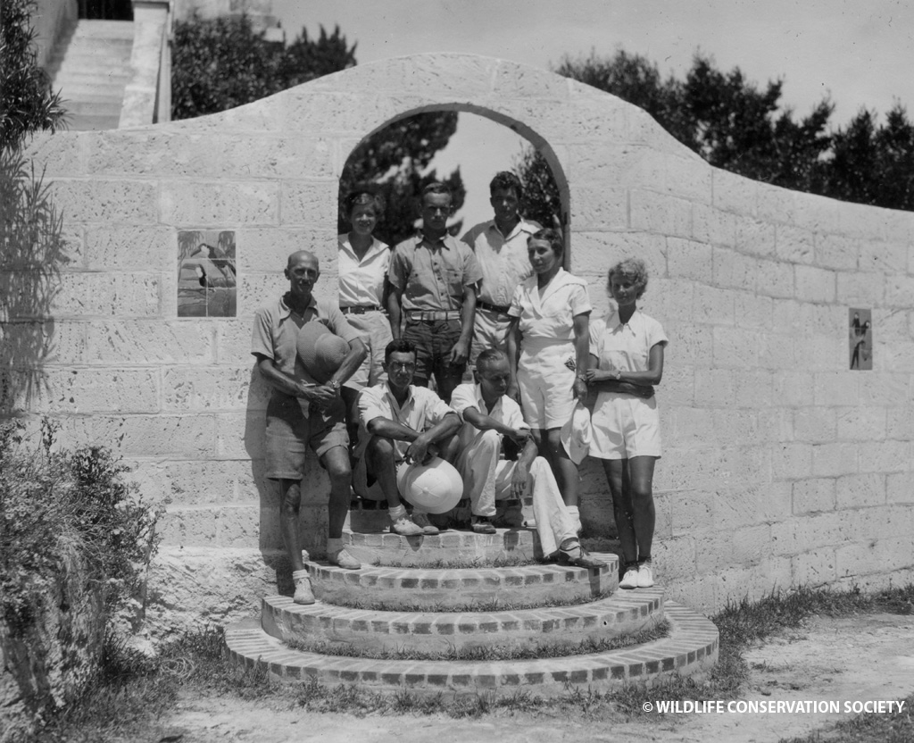 William Beebe and associates pose at gate in Nonsuch Island, Bermuda. WCS Photo Collection