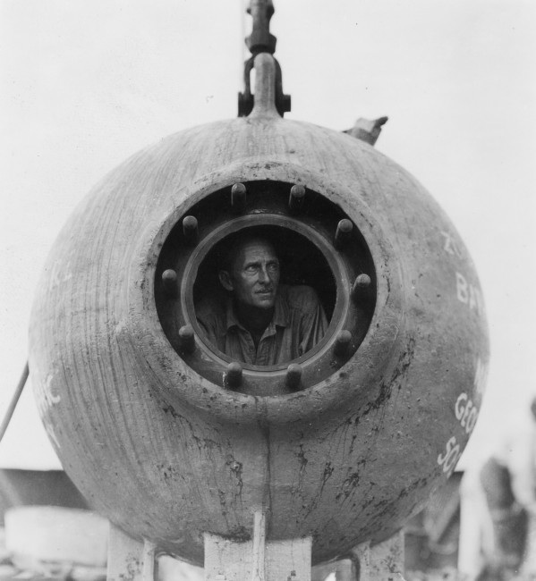 William Beebe peers out of the Bathysphere, 1934. WCS Photo Collection