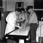 wildlife-conservation-society_19321_cbs-radio-broadcast-at-hospital-goss-treating-lion-cub_bz_06-00-41-wm